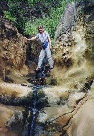 Jane Kurtz hiking in an eerie and wonderful gorge
